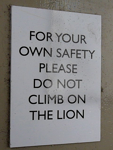 Funny sign: do-not-climb-on-the-lion