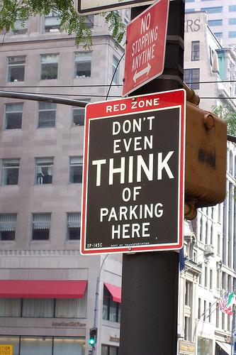 funny sign: dont-even-think-of-parking-here