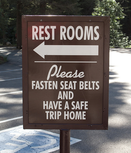 funny sign rest rooms fasten seat belts