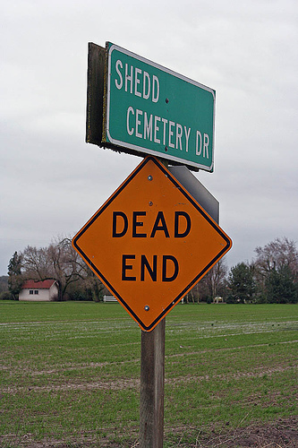 Sign of cemetery drive and dead end